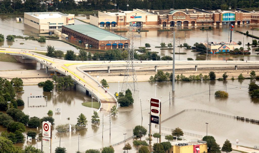 A shopping center — which includes a Target, Kohl's, PetSmart, Bed Bath & Beyond and Old Navy — along Interstate 69 is flooded by rainwater left from Hurricane Harvey in Humble. Hurricane Harvey inundated the Houston area with several feet of rain.
