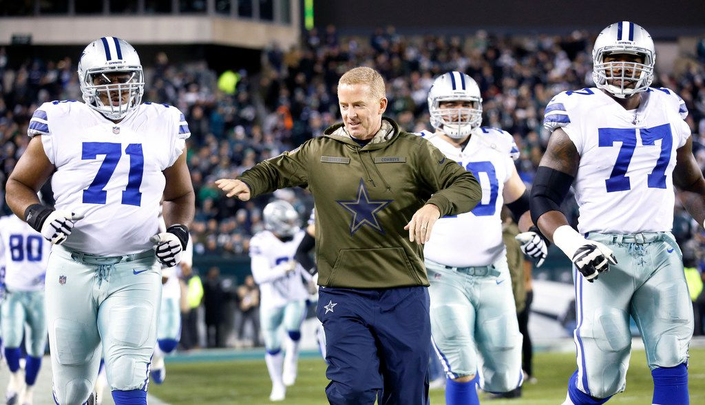 Dallas Cowboys head coach Jason Garrett leads offensive tackle La'el Collins (71), offensive tackle Tyron Smith (77) and the rest of the team onto the field to face the Philadelphia Eagles at Lincoln Financial Field in Philadelphia, Pennsylvania, Sunday, November 11, 2018. (Tom Fox/The Dallas Morning News)