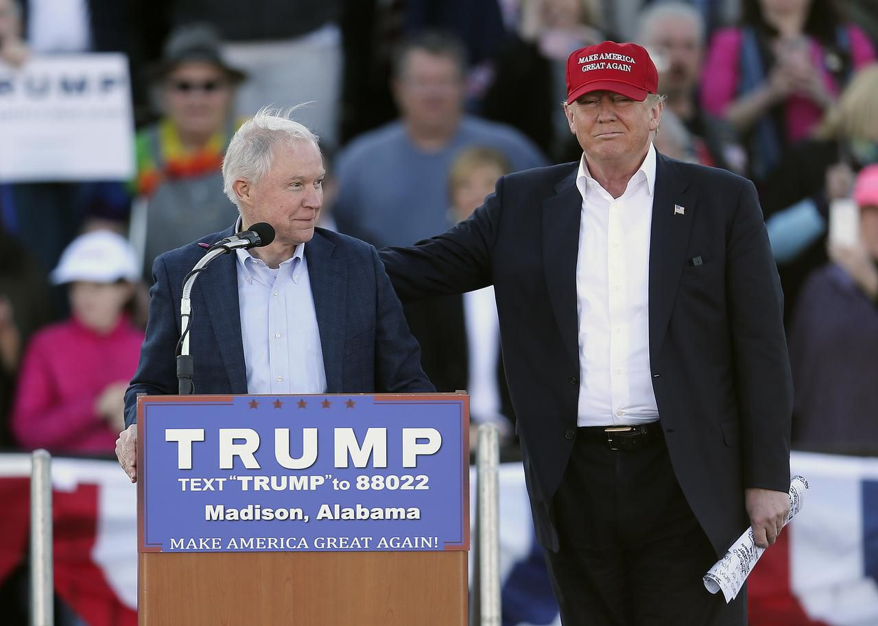 Republican presidential candidate Donald Trump, right, stands next to Sen. Jeff Sessions, R-Ala., as Sessions speaks during a rally in Madison, Ala.
