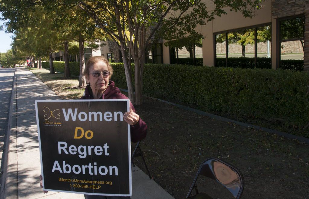 Lupe Del Angel holds a sign outside of the Southwestern Women's Surgery Center in Dallas on Friday, Nov. 1, 2013. A third of the abortion clinics in Texas can no longer perform the procedure starting Friday after a federal appeals court allowed most of the state's new abortion restrictions to take effect.