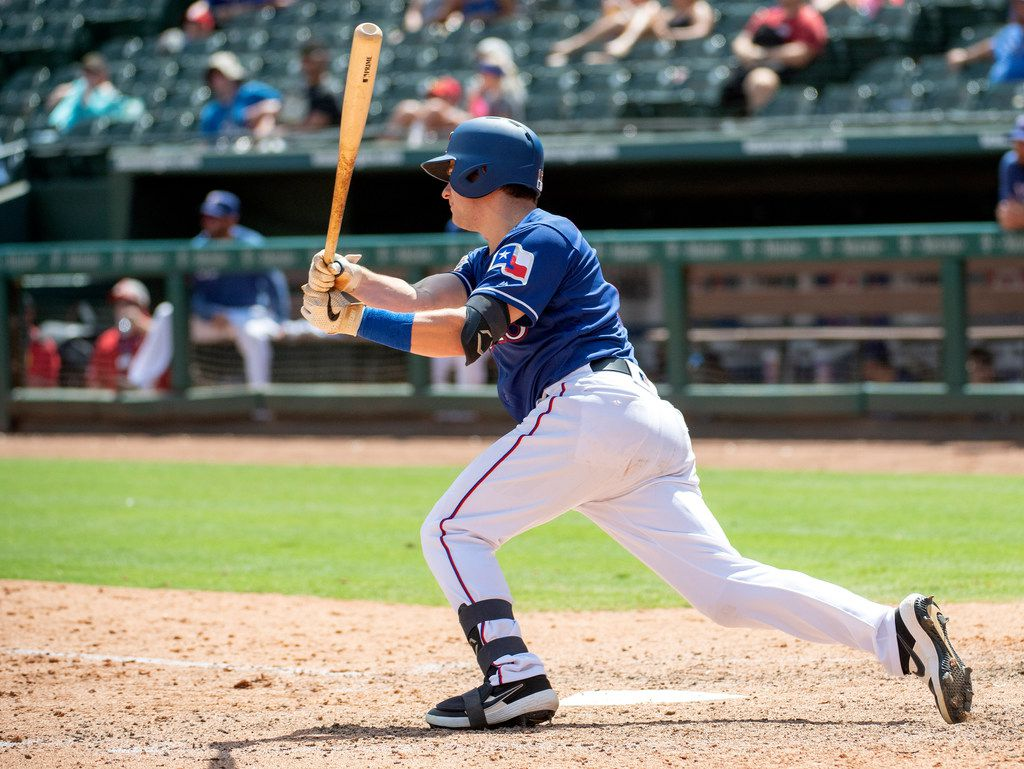 Texas Rangers' Nick Solak follows through on a single off of Los Angeles Angels starting pitcher Andrew Heaney during the seventh inning of the first baseball game of a doubleheader Tuesday, Aug. 20, 2019, in Arlington, Texas. The single was Solak's first major league hit. (AP Photo/Jeffrey McWhorter)