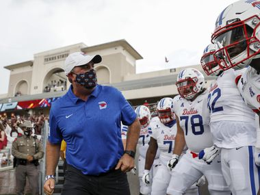 SAN MARCOS, TEXAS - SEPTEMBER 05: Head coach Sonny Dykes of the Southern Methodist Mustangs leads the team on to the field before the game against the Texas State Bobcats at Bobcat Stadium on September 05, 2020 in San Marcos, Texas.