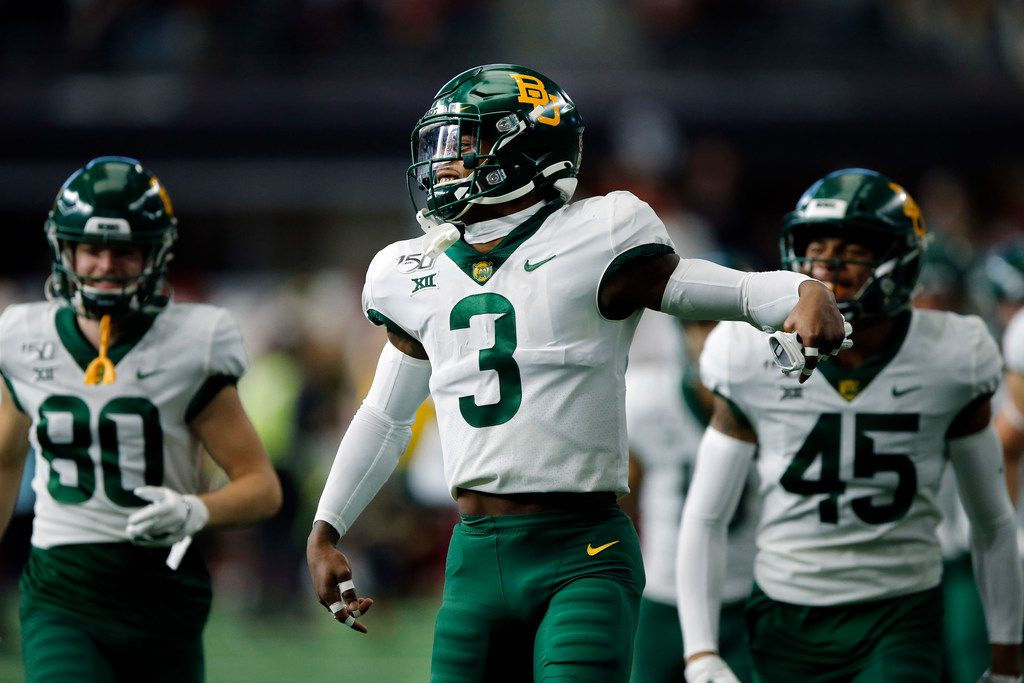 Baylor Bears safety Chris Miller (3) leads him team onto the field during team introductions before the Big 12 Championship game with the Oklahoma Sooners at AT&T Stadium in Arlington, Saturday, December 7, 2019.