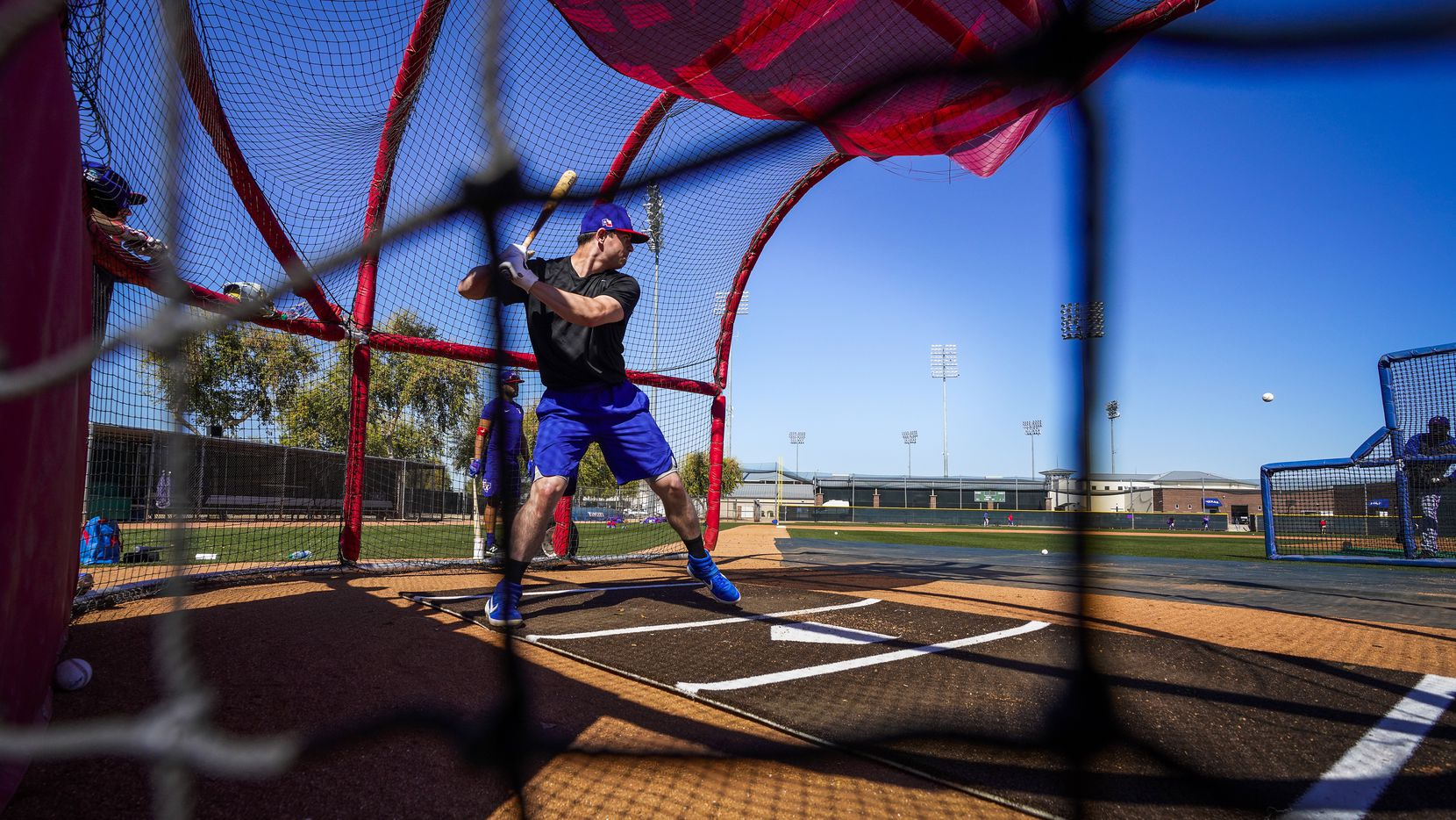 Texas Rangers infielder Nick Solak takes batting practice during a spring training workout at the team's training facility on Friday, Feb. 14, 2020, in Surprise, Ariz.