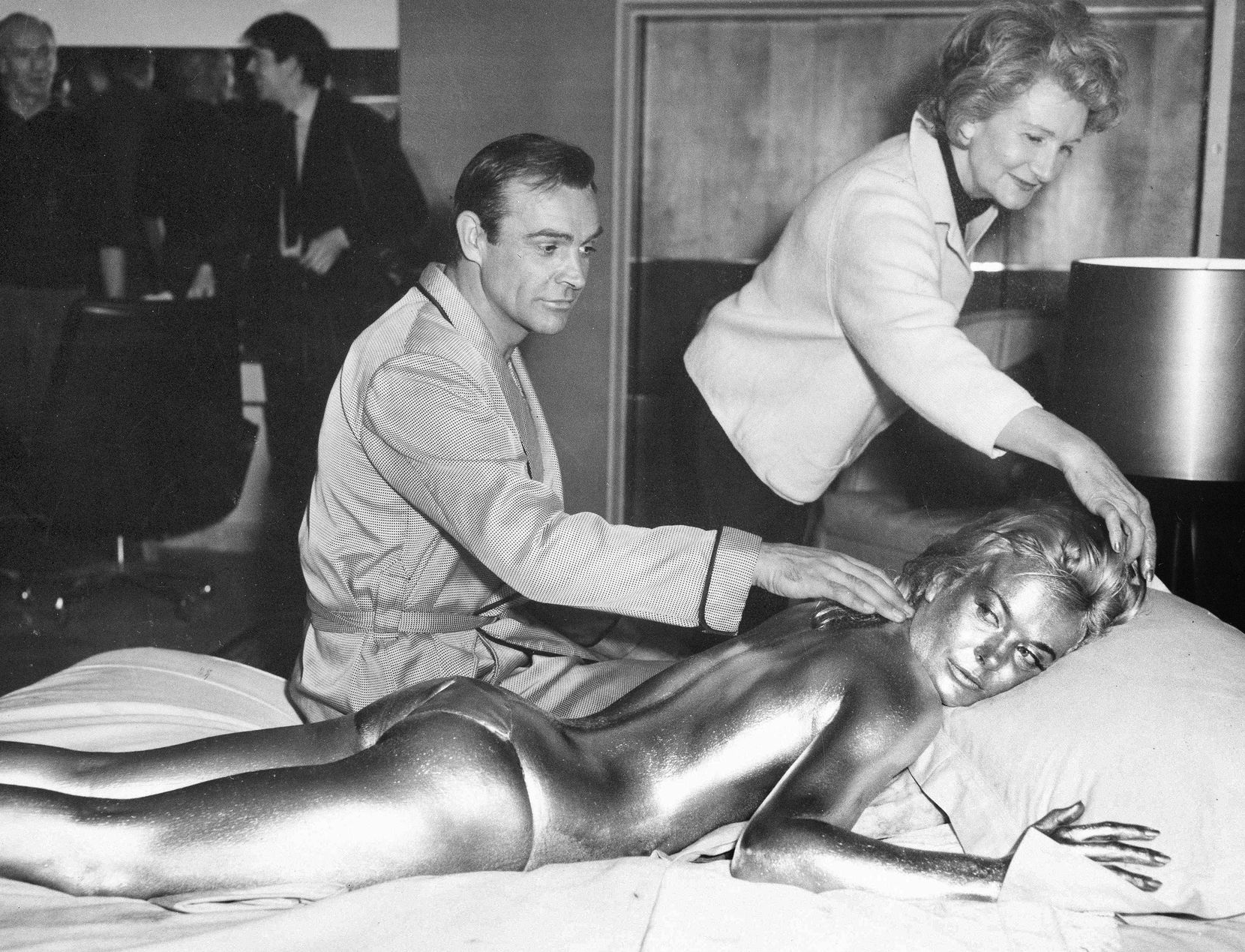 """In 1964, James Bond, aliasean Connery, finds himself in a sticky situation with actress Shirley Eaton at Pinewood Studios, near London. Eaton was given a liberal coating of gold paint for a scene in the Bond thriller """"Goldfinger."""""""