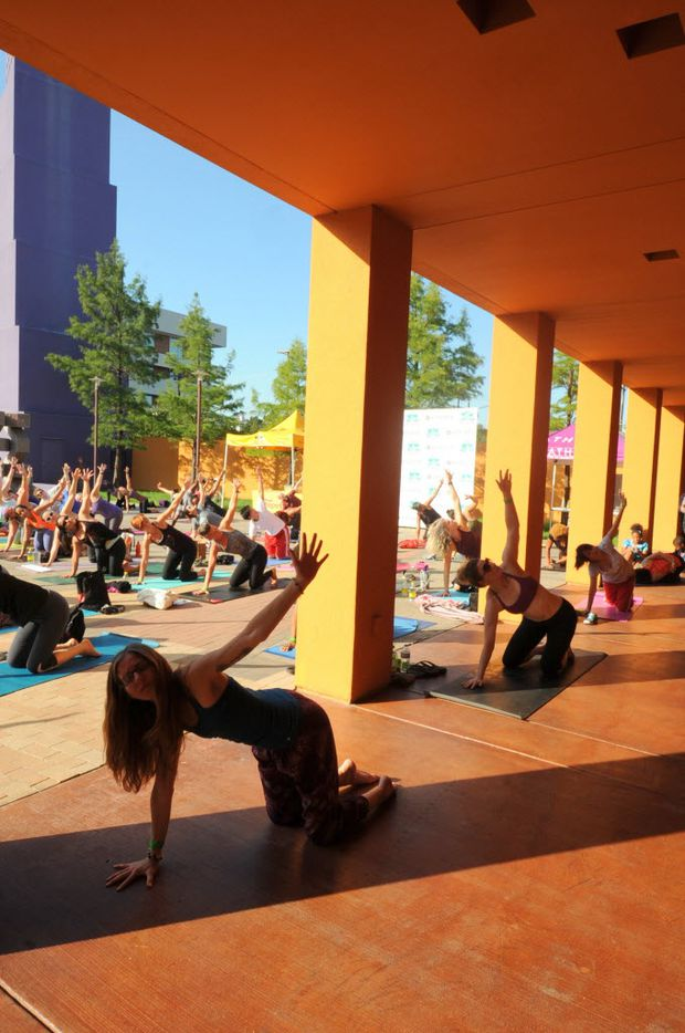Yogis practice at the D-FW Free Day of Yoga Kickoff at the Latino Cultural Center in Dallas, TX on September 3, 2016. (Alexandra Olivia/ Special Contributor)
