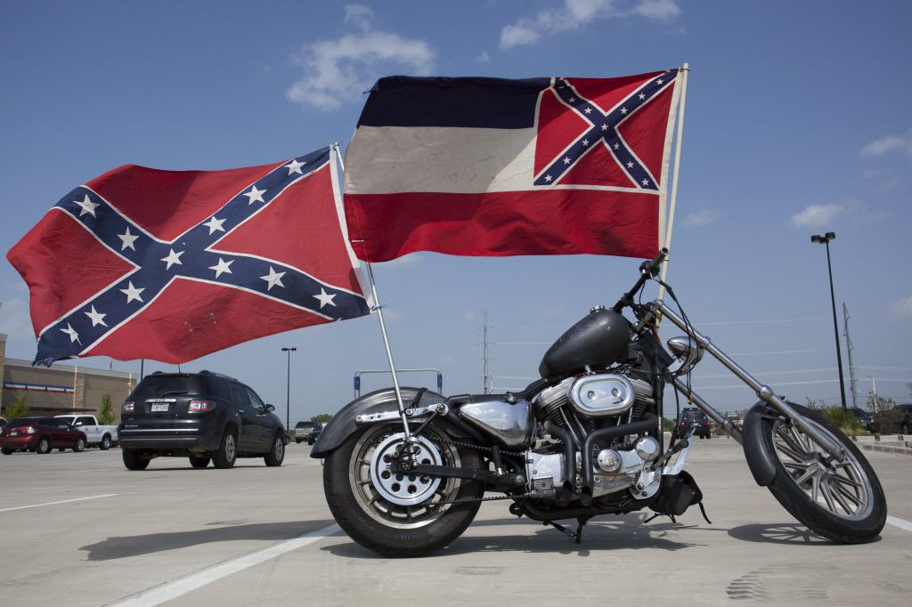 Confederate flags fly from a motorcycle in the Academy parking lot in Denton in this file photo. A student at Royse City High School wore one like a cape during a late April school day.