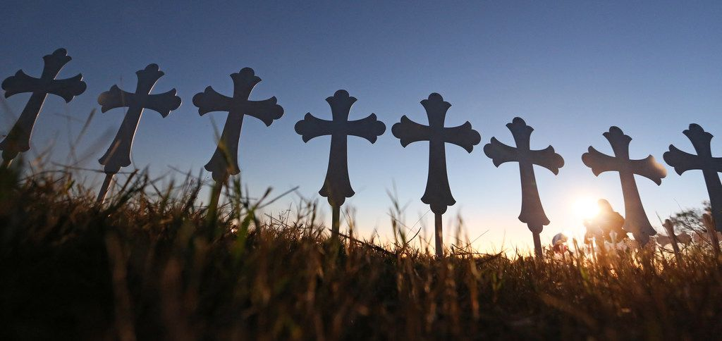 Some of the 26 crosses placed in a field are silhouetted in the evening light in Sutherland Springs, Texas to honor those who were killed in Sunday's mass shooting, when a gunman opened fire at a Baptist church in the small town southeast of San Antonio. Photographed on Monday, November 6, 2017.