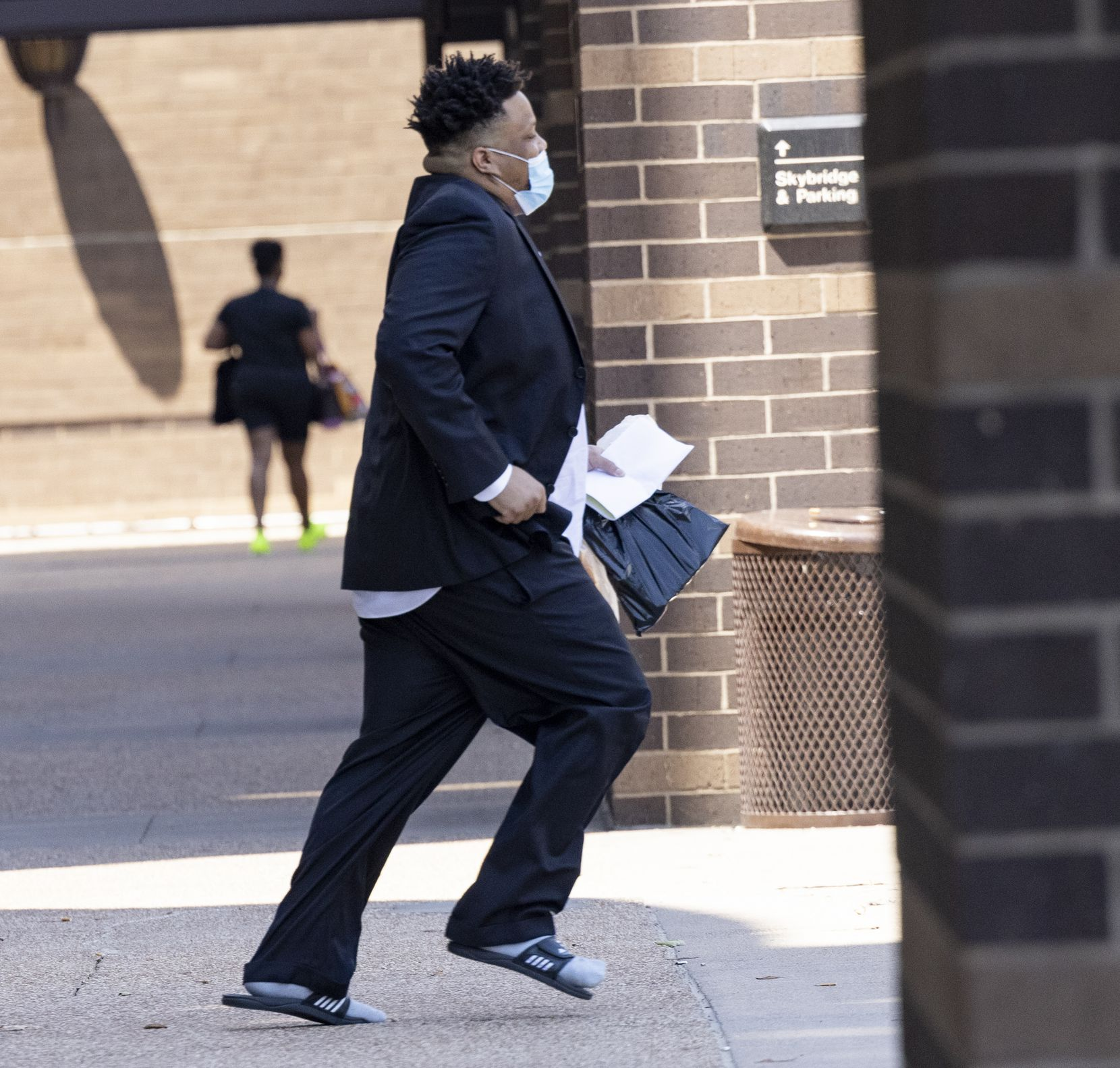 Jonathan Pitts leaves after visiting the pre-trial services office on Monday, Aug. 16, 2021, at the Frank Crowley Courts Building in Dallas. Pitts, a murder suspect scheduled to go on trial this week, was released from Dallas County jail after it was revealed that the city may have lost evidence in his case. (Juan Figueroa/The Dallas Morning News)