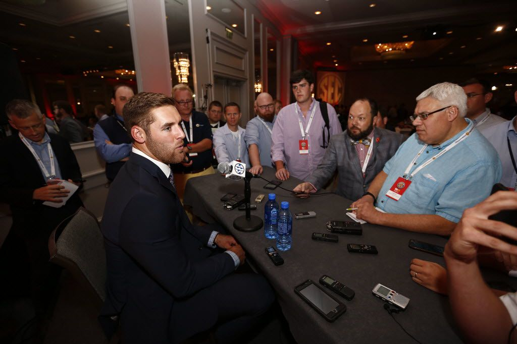 FILE - In this July 12, 2016, file photo, Texas A&M quarterback Trevor Knight speaks to the media at the Southeastern Conference NCAA college football media days, in Hoover, Ala. Texas A&M's defense should be just fine with Myles Garrett and Daeshon Hall teaming to form perhaps the best defensive end duo in the country. Things are much less sure on offense where graduate transfer Trevor Knight takes over at quarterback. (AP Photo/Brynn Anderson, File)