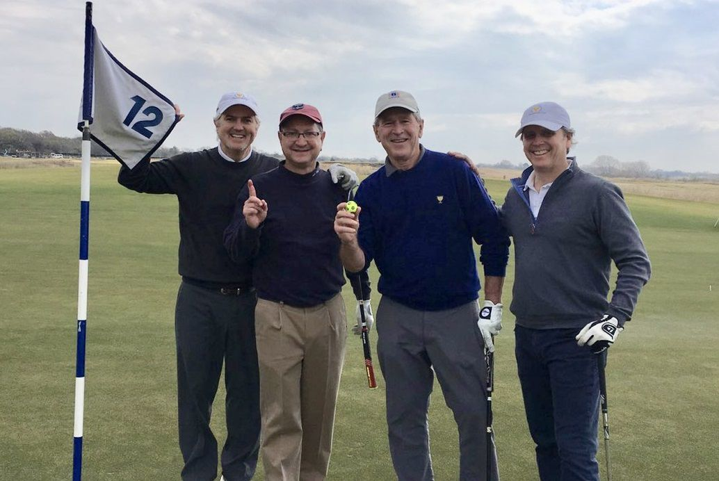 George W Bush celebrates his hole in one on 12 at Trinity Forest.