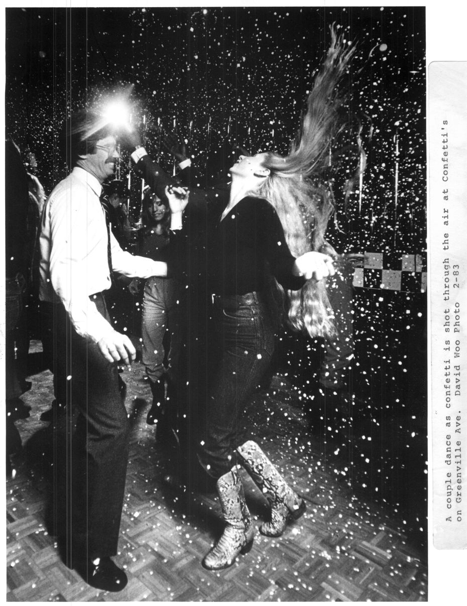 "A couple dance amid falling confetti at Greenville club that bills itself as a ""fundrinkery."" Published in the issue on March 6, 1983."