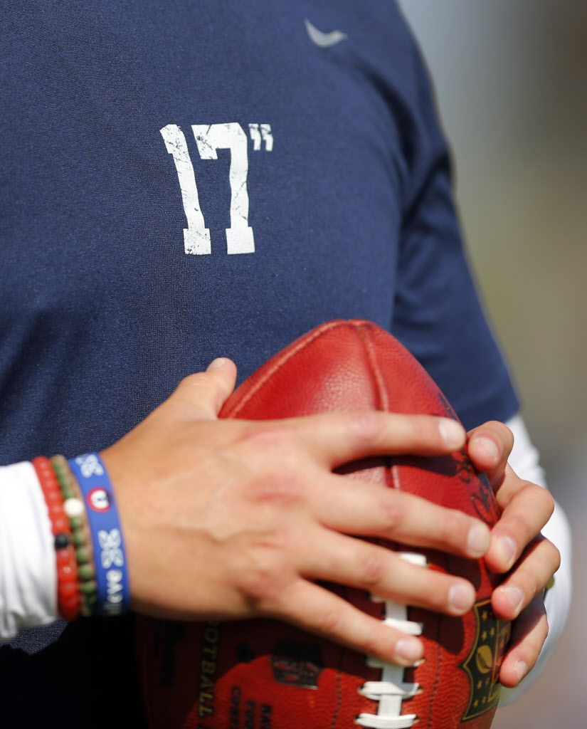 """A Dallas Cowboys ballboy wears one of the inspirational 17"""" t-shirts during afternoon practice at training camp in Oxnard, California, Friday, August 5, 2016. The 17"""" is a reference by the late Cal-Poly Pomona college baseball coach John Scolinos who said home plate is 17"""" no matter what diamond you play on. Dallas Cowboys head coach Jason Garrett has taken it on as a accountability reminder. (Tom Fox/The Dallas Morning News)"""