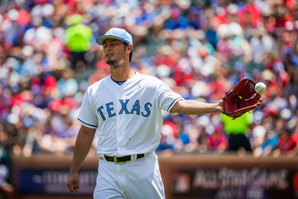 Texas Rangers starting pitcher Yu Darvish gets a new ball after giving up a two-run home run to Seattle Mariners first baseman Danny Valencia during the first inning at Globe Life Park on Sunday, June 18, 2017, in Arlington. (Smiley N. Pool/The Dallas Morning News