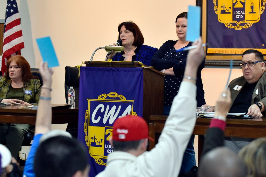 Carol Donovan, chairwoman of the Dallas County Democratic Party, (left at podium) with Sarah Duncan, the Democratic Party lawyer, asked for a vote while discussing a lawsuit filed by the Dallas Republican Party against chairwoman Donovan and the local Democratic party, during the Dallas County Democratic Party Executive Committee Meeting at the Communications Workers of America Union Hall in Dallas, on Jan. 22, 2018.