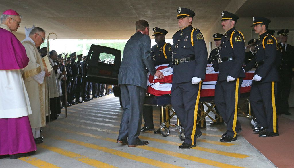 The body of Officer Rogelio Santander is carried to the hearse after the funeral at Lake Pointe Church in Rockwall.