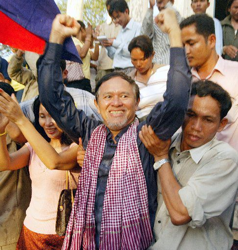 Kem Sokha from the U.S.-funded Cambodian Center for Human Rights celebrates with his supporters outside Prey Sar prison on the outskirts of Phnom Penh, Cambodia, Tuesday, Jan. 17, 2006. Sokha is one of four prominent critics of the Cambodian government who had been arrested on defamation charges filed by Prime Minister Hun Sen and released on bail.