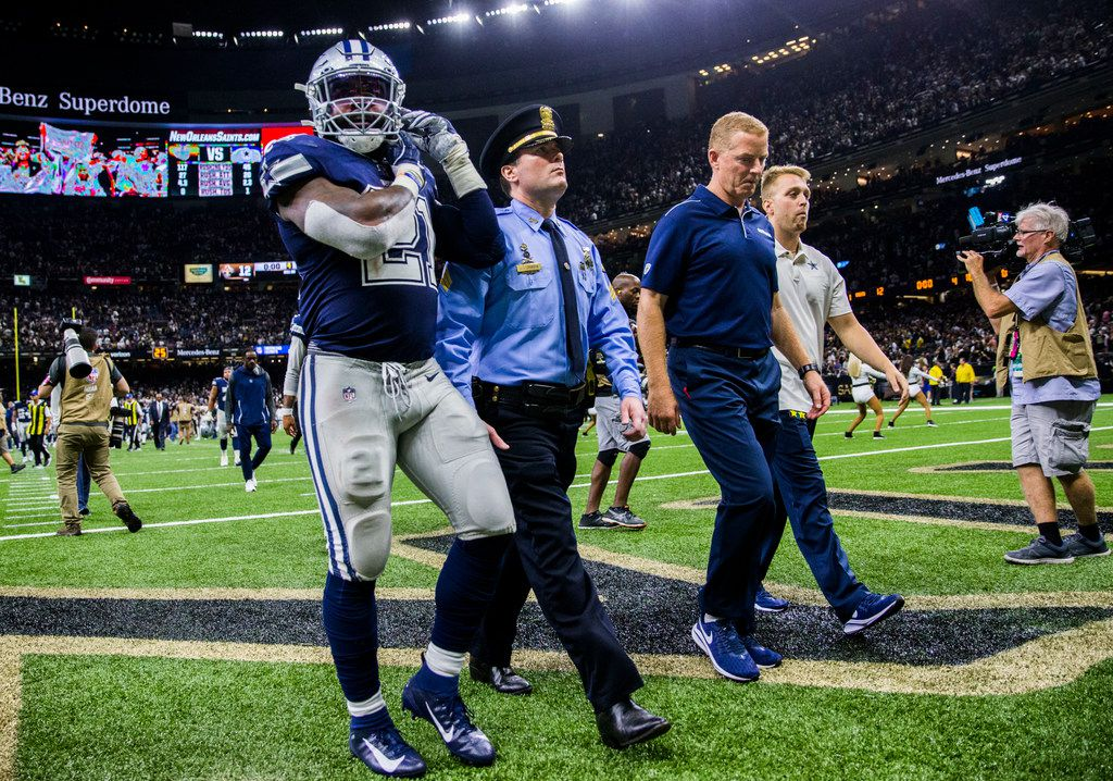 Dallas Cowboys running back Ezekiel Elliott (21) and head coach Jason Garrett leave the field after a 12-10 loss to the New Orleans Saints on Sunday, September 29, 2019 at Mercedes-Benz Superdome in New Orleans, Louisiana.