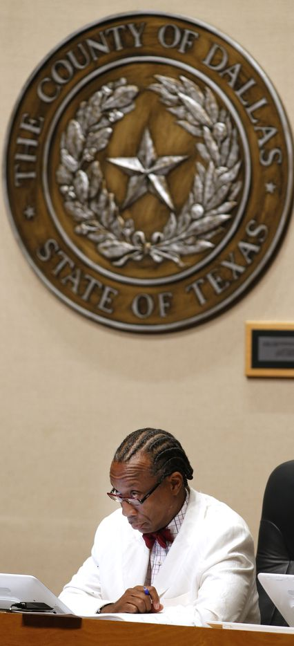 Dallas County Commissioner John Wiley Price listens during the county court proceedings on August 26, 2014. Commissioner Cantrell read a resolution that would ask the district attorney to remove Price from office while the federal corruption charges against him are pending.