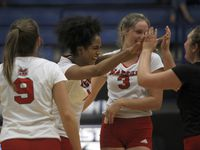 Flower Mound Marcus' Madison Dyer (center) celebrates during Tuesday's 25-21, 25-22, 25-22 victory over Plano West. (Steve Hamm/ Special Contributor)