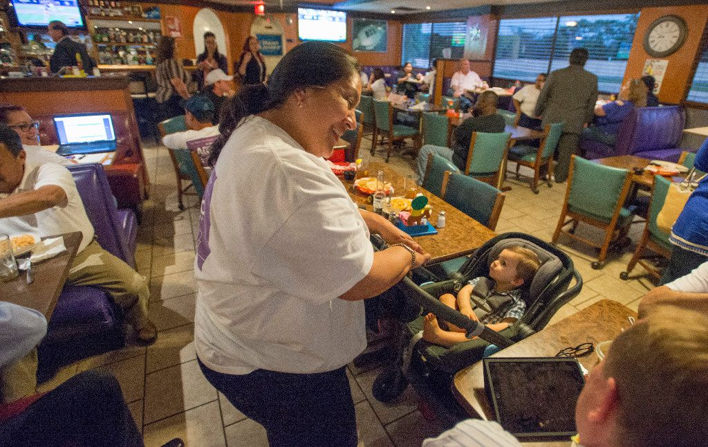 Mayor Pro Tem Monica Alonzo, incumbent and runoff candidate in the Place 6 Dallas City Council election, plays with 10-month-old Jacob Valentine, son of Ed Valentine, one of Alonzo's supporters, at a dinner she hosted for her campaign volunteers at Buena Vista restaurant.