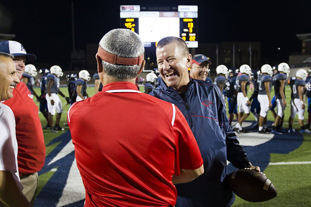 Allen head coach Tom Westerberg clutches a game ball as he celebrates with his assistants during after a win over Hebron in a high school football game at Eagle Stadium on Friday, Oct. 9, 2015, in Allen. Allen won the game 45-13 for the Eagles 50th consecutive victory. (Smiley N. Pool/The Dallas Morning News)
