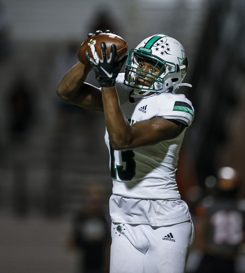 Southlake Carroll junior wide receiver RJ Maryland (13) catches a pass for a touchdown during the first half of a high school football game against Rockwall at Wilkerson-Sanders Stadium in Rockwall, Thursday, October 8, 2020. (Brandon Wade/Special Contributor)