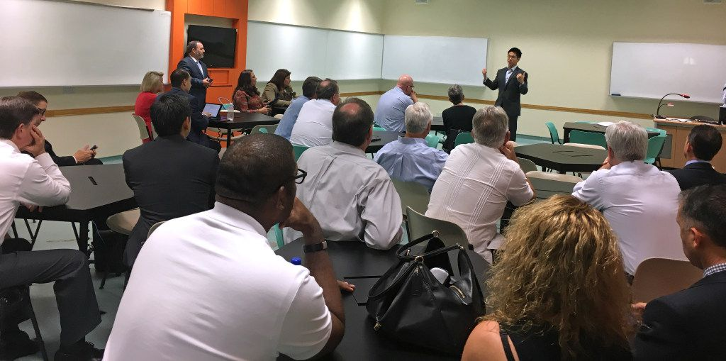 Joseph Lim, manager of global education innovation at the National Institute of Education, shares how Singapore trains future teachers with a group of Texas superintendents, college deans, business representatives and other leaders from the state. (Eva-Marie Ayala/Staff)