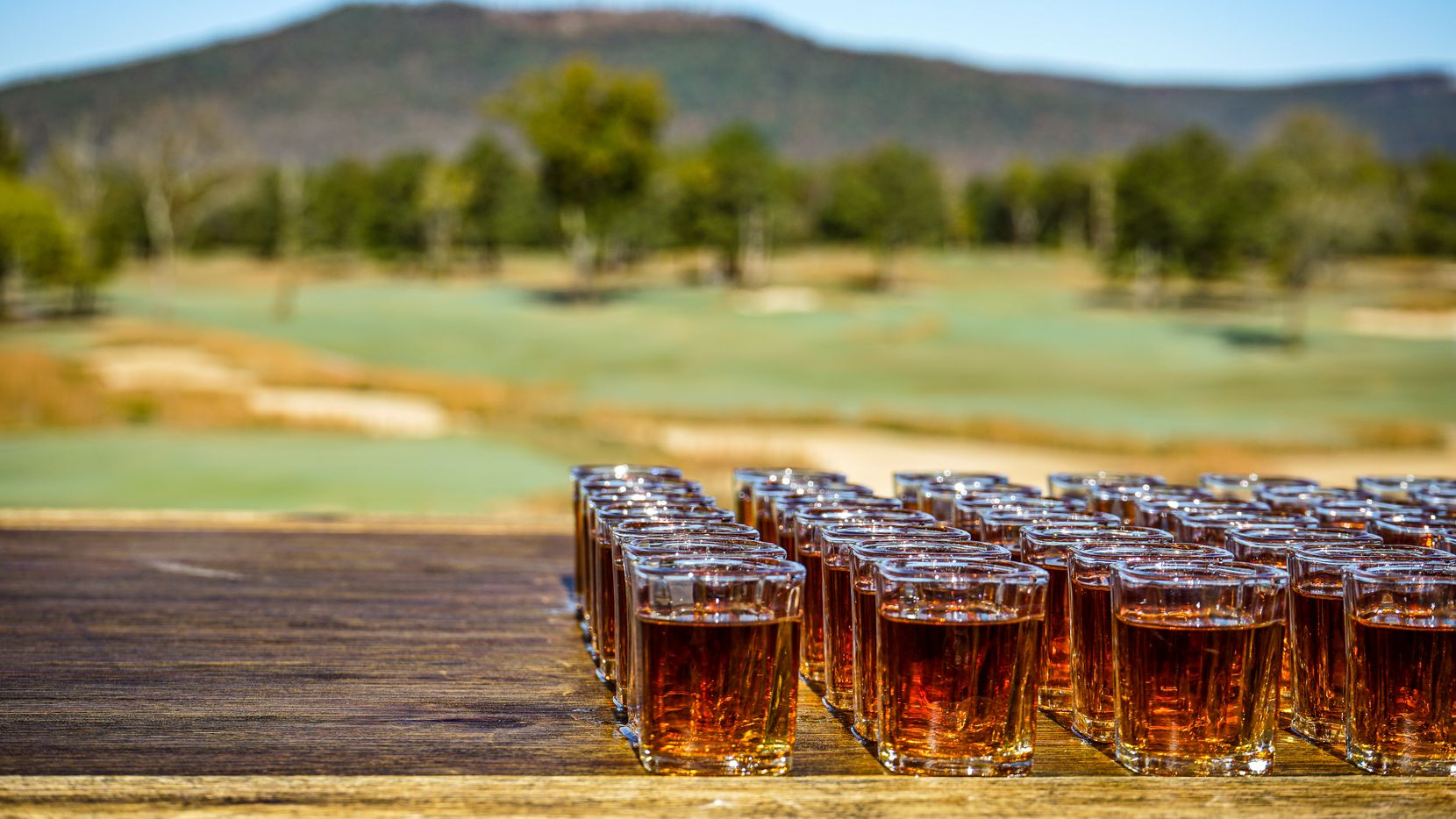 As the story goes, visitors to Sweetens Cove Golf Club in Tennessee would take a shot of whiskey before the first hole. After athletes Peyton Manning, Andy Roddick and others took ownership of Sweetens Cove Golf Club, they decided to have a bourbon made with the Sweetens Cove name. The bourbon becomes available in Texas for the first time starting April 21, 2021.