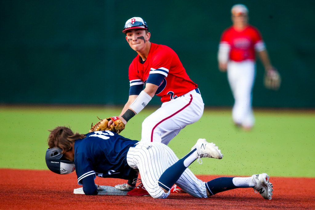 Allen right fielder Sam Haigwood (10) loses his helmet as he steals second base as McKinney Boyd's Brody Clark (2) makes a late tag during a district 9-6A baseball game at McKinney Boyd baseball field in McKinney, Texas on Friday, April 12, 2019. (Shaban Athuman/Staff Photographer)