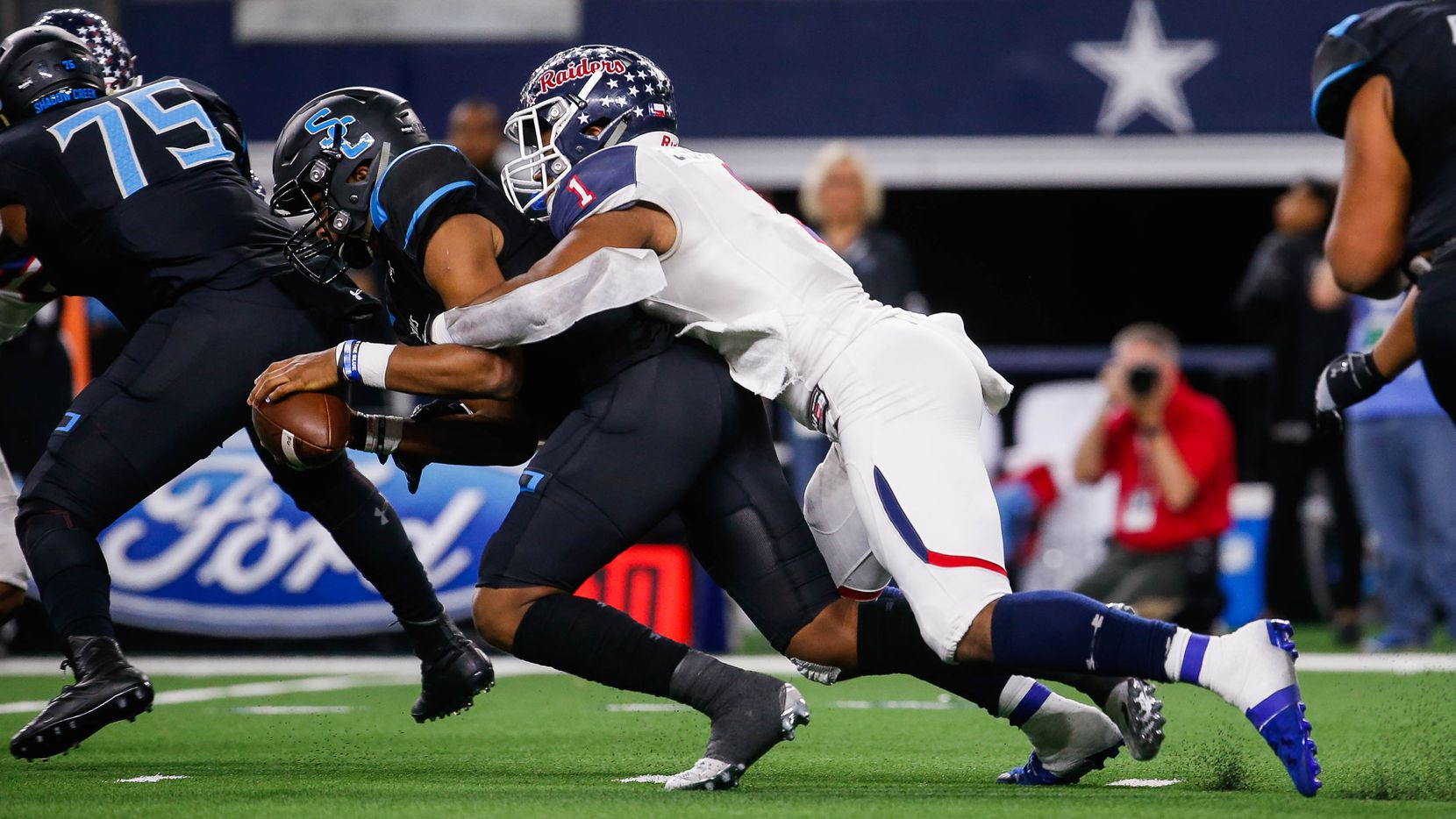 Denton Ryan's defensive lineman Ja'Tavion Sanders (1) sacks Alvin Shadow Creek's quaterback Kyron Drones in the first quarter of a Class 5A Division I state championship game at the AT&T Stadium in Arlington, on Friday, December 20, 2019. Shadow Creek leads at halftime 14-8. (Juan Figueroa/The Dallas Morning News)
