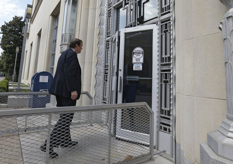 Jeff Mateer, first assistant to attorney general, enters the Eldon B. Mahon U.S. Courthouse in Fort Worth.