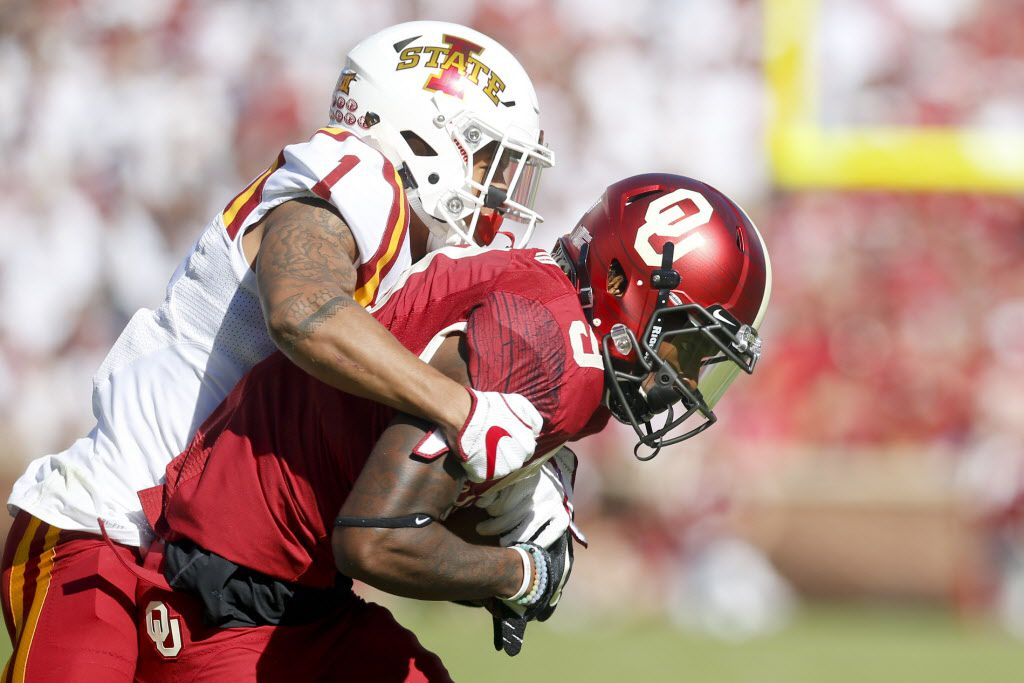 FILE - Iowa State defensive back D'Andre Payne (1) tackles Oklahoma wide receiver CeeDee Lamb (9) during a game in Norman, Okla., on Saturday, Oct. 7, 2017. (Ian Maule/Tulsa World via AP)