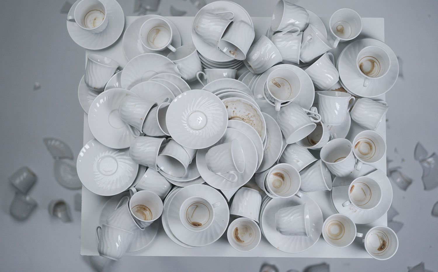 "Dishes pile up in Nida Bangash's ""Sight_Plan,"" a two-channel video installation."