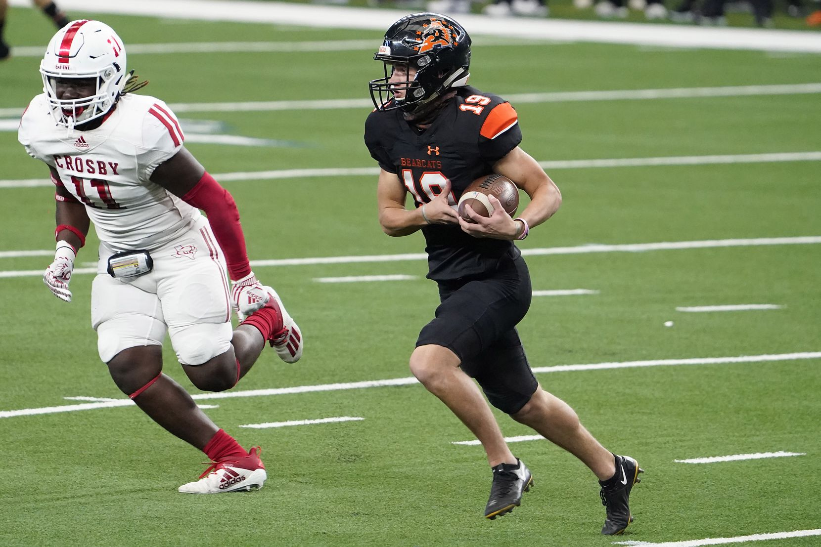 Aledo punder Clay Murador (19) gets past Crosby linebacker Jamauri Johnson (11) for a first down on a fake punt during the first half of the Class 5A Division II state football championship game at AT&T Stadium on Friday, Jan. 15, 2021, in Arlington. (Smiley N. Pool/The Dallas Morning News)