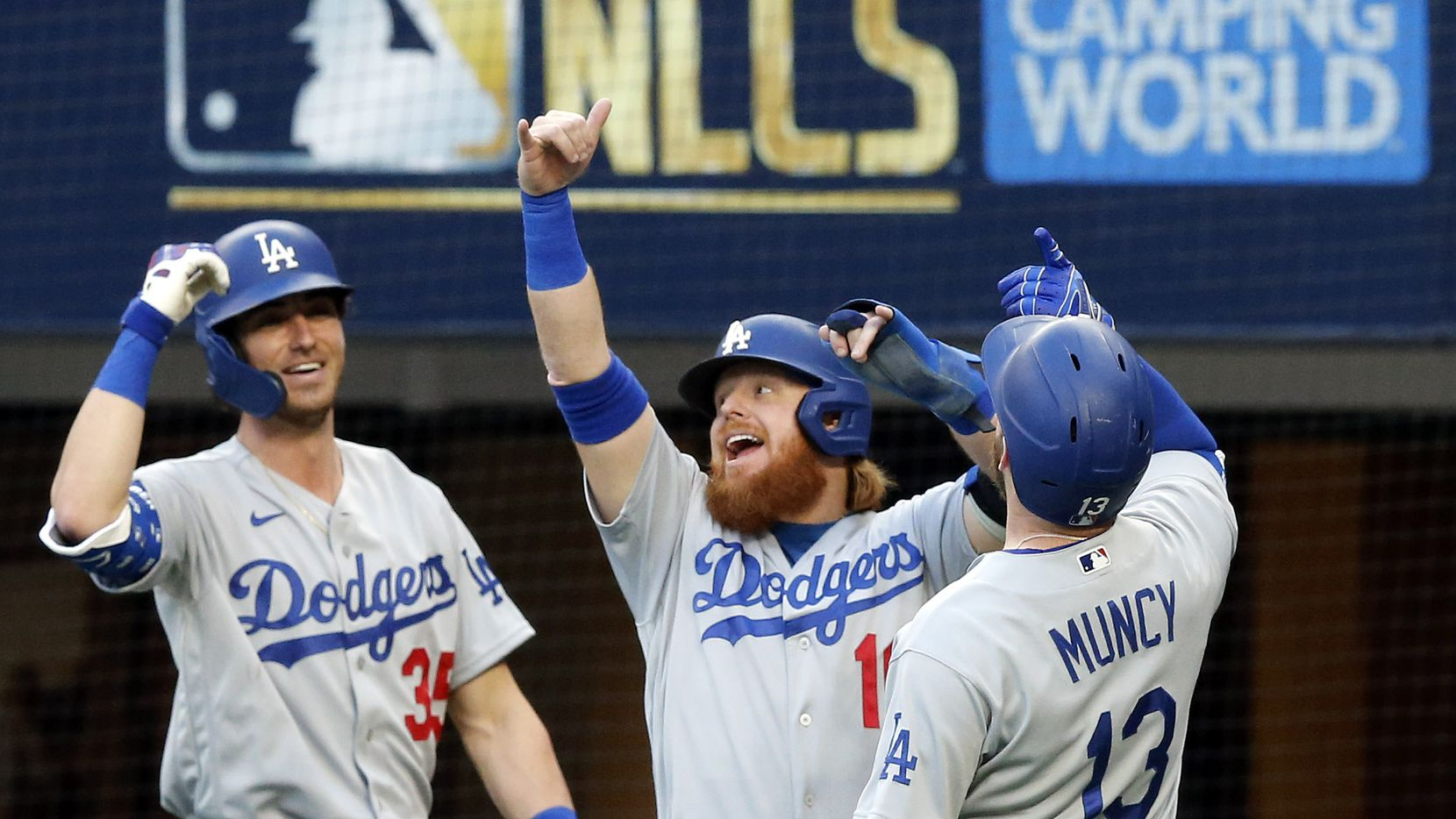 Los Angeles Dodgers Justin Turner (10) and Cody Bellinger (35) celebrate Max Muncy's (13) first inning grand slam in Game 3 of the National League Championship Series at Globe Life Field in Arlington, Wednesday, October 14, 2020.