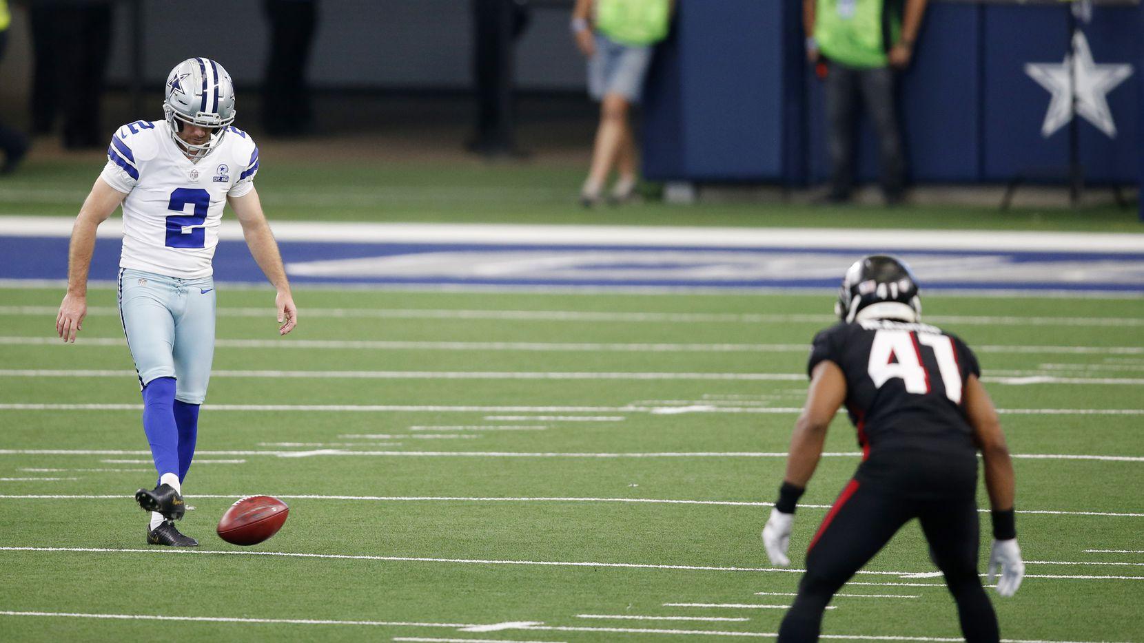 Dallas Cowboys kicker Greg Zuerlein (2) attempts an onside kick against the Atlanta Falcons during the fourth quarter of play at AT&T Stadium in Arlington, Texas on Sunday, September 20, 2020. Dallas Cowboys defeated the Atlanta Falcons 40-39.