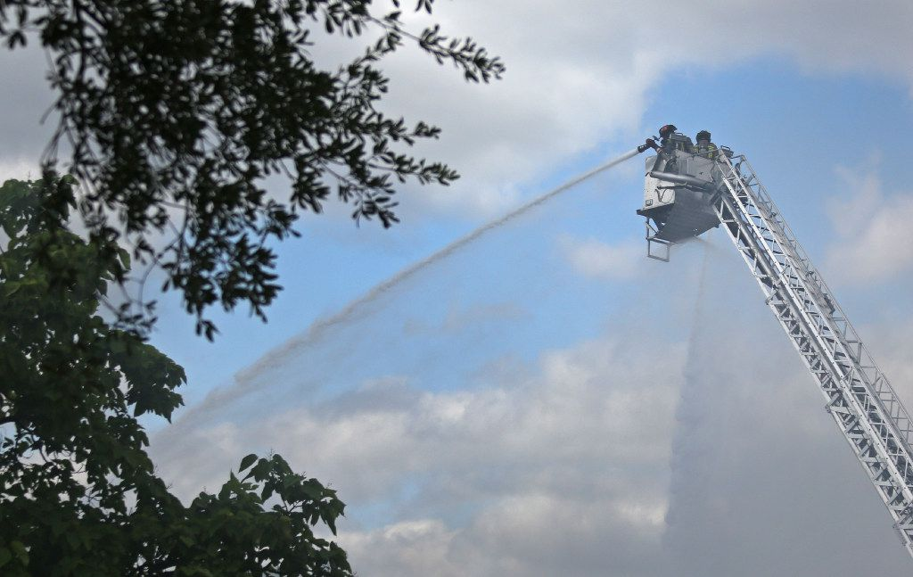 Firefighters battle a blaze at the Appleseed Academy in Mesquit. (Louis DeLuca/The Dallas Morning News)