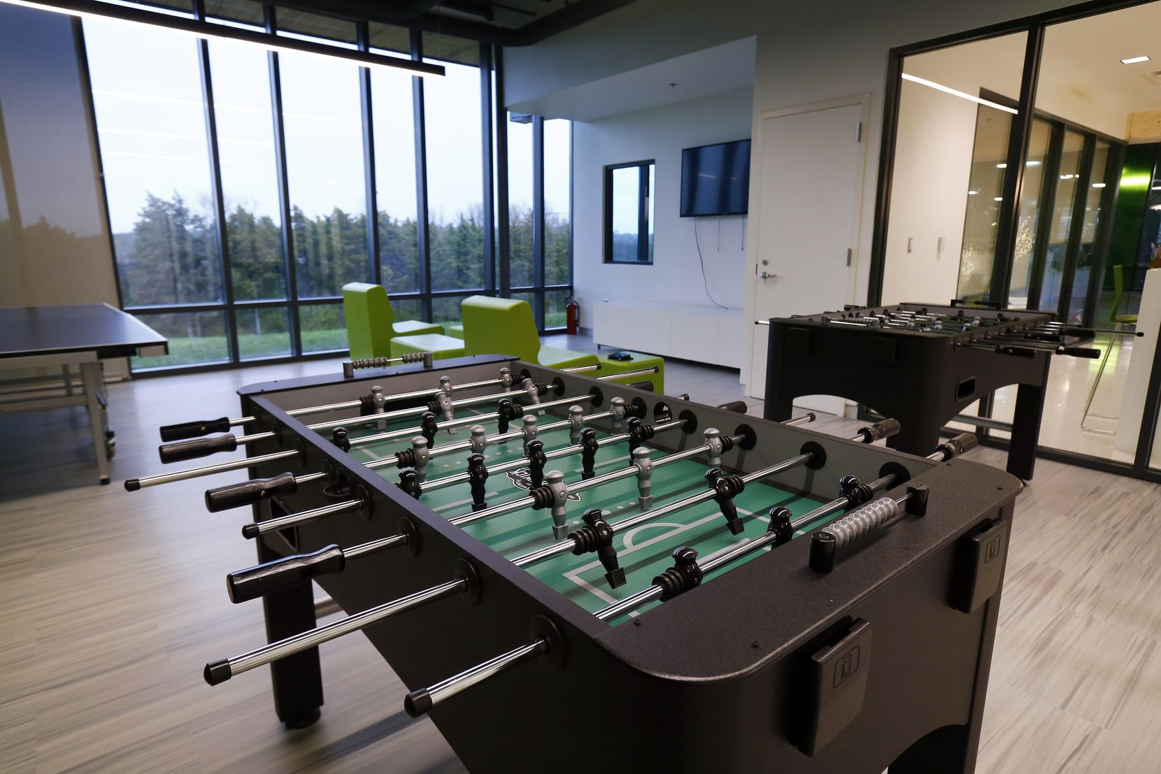 One of the game rooms inside the newly opened Singing Hills Recreation Center in Oak Cliff. At present, capacity in various areas of the center must remain capped at 25%.