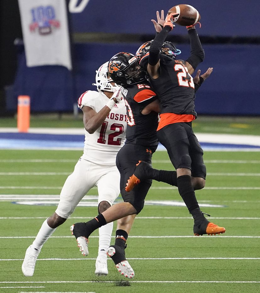 Aledo defenders Jaden Allen (27) and Elijah Valencia (23) break up a pass intended for Crosby wide receiver Jaylen Herman (12) during the second half of a 56-21 victory over Crosby to win the Class 5A Division II state football championship game at AT&T Stadium on Friday, Jan. 15, 2021, in Arlington. The victory gave the Bearcats the 10th state championship in school history. (Smiley N. Pool/The Dallas Morning News)