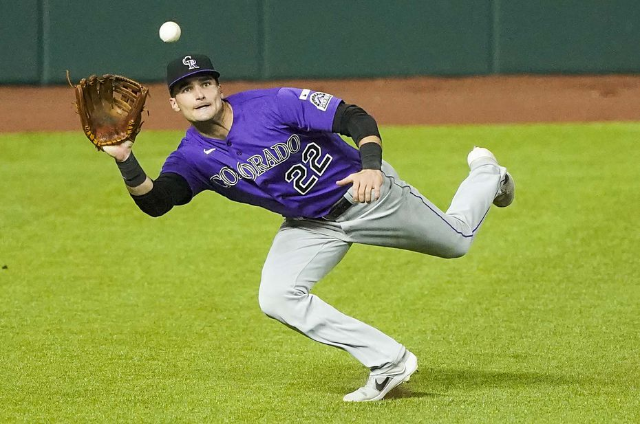Colorado Rockies left fielder Sam Hilliard makes a running catch on a line drive off the bat of Texas Rangers first baseman Todd Frazier during the sixth inning on opening day at Globe Life Field on Friday, July 24, 2020.