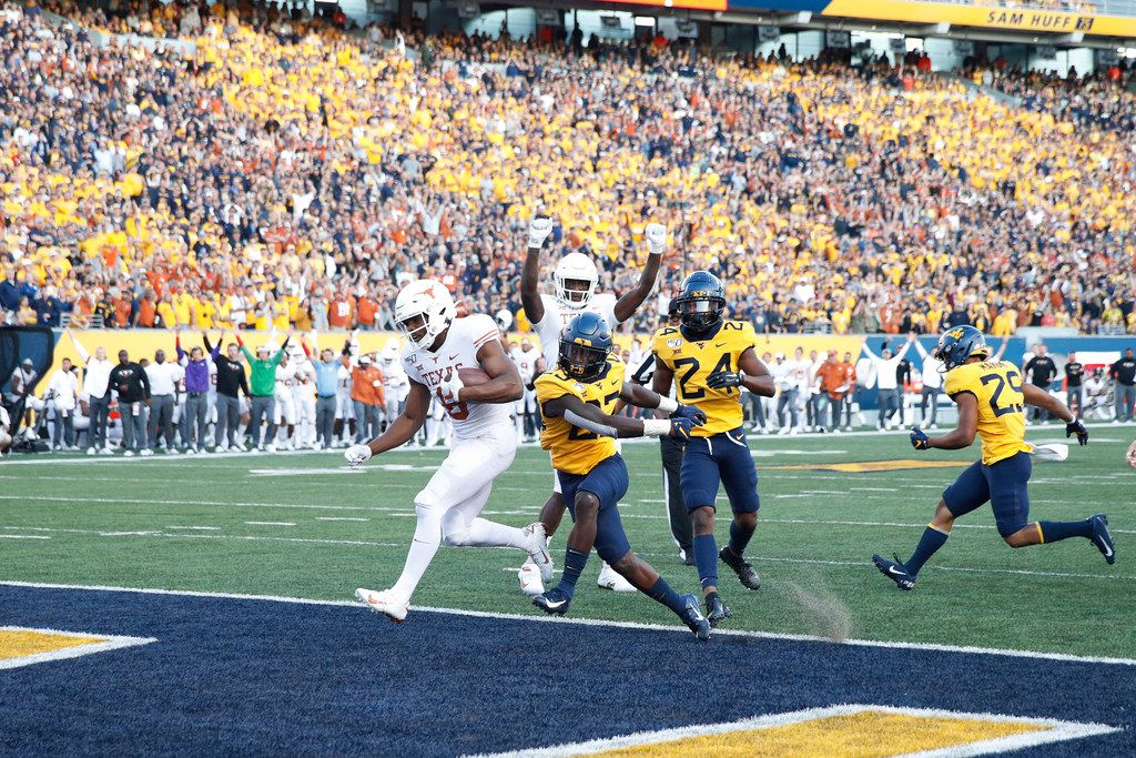 MORGANTOWN, WV - OCTOBER 05: Devin Duvernay #6 of the Texas Longhorns runs into the end zone with a 13-yard touchdown run in the fourth quarter against the West Virginia Mountaineers at Mountaineer Field on October 5, 2019 in Morgantown, West Virginia. Texas defeated West Virginia 42-31. (Photo by Joe Robbins/Getty Images)