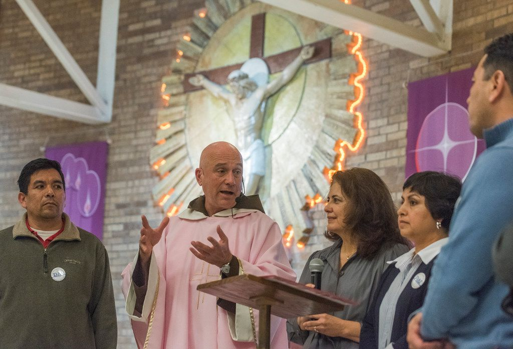 The Rev. Luis Gerardo Arraiza of Our Lady of Lourdes Catholic Church encourages church members to apply for citizenship while standing next to Socorro Perales (center) and Xochi Guerra from Dallas Area Interfaith after Sunday services on  Dec. 17, 2017.