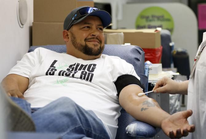 Justin Jenkins prepares to give blood at a Carter BloodCare drive and Be The Match bone marrow registry that he organized in Rowlett.