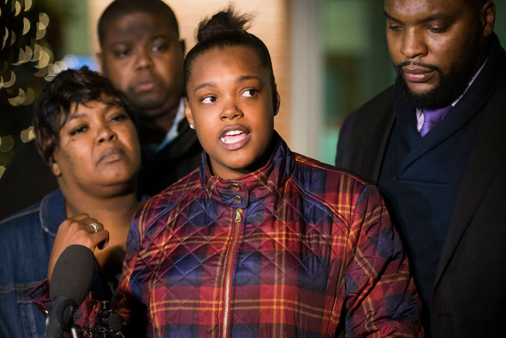 Jacqueline Craig (left) listens as her 19-year-old daughter Brea Hymond addresses the media during a news conference Thursday night outside the Fort Worth Police Department's Bob Bolen Public Safety Complex.