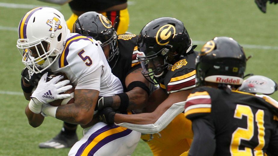 Prairie View A&M's Ahmad Antoine (5) picks up a first down as he attracted the attention of Grambling State defenders during a first half rush. The two teams were forced to postpone their annual fall state fair classic, scheduled for the Cotton Bowl in Dallas, due to the pandemic. The rescheduled game was played at Globe Life Park in Arlington on March 13, 2021.