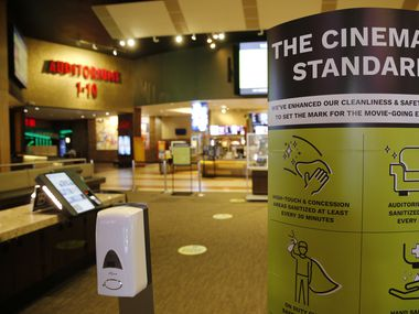 Signage noting new cleanliness and safety measures at Cinemark West in Plano, one of the locations that will reopen on Friday with new safety measures. On Thursday, less than 50 workers were laid off from the Plano workforce as theaters struggle to recover after nearly three months of closures.