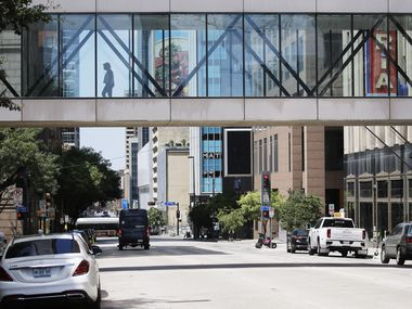 The absence of traffic on Elm Street in downtown Dallas on Tuesday, Aug. 11, shows how the central business district has gone on pause.