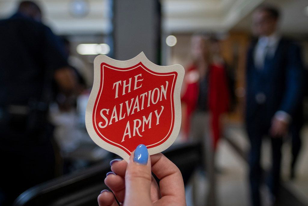A supporter of the Salvation Army's proposed 20-acre campus along an industrial corridor of Stemmons Freeway handed out stickers before Wednesday's meeting.
