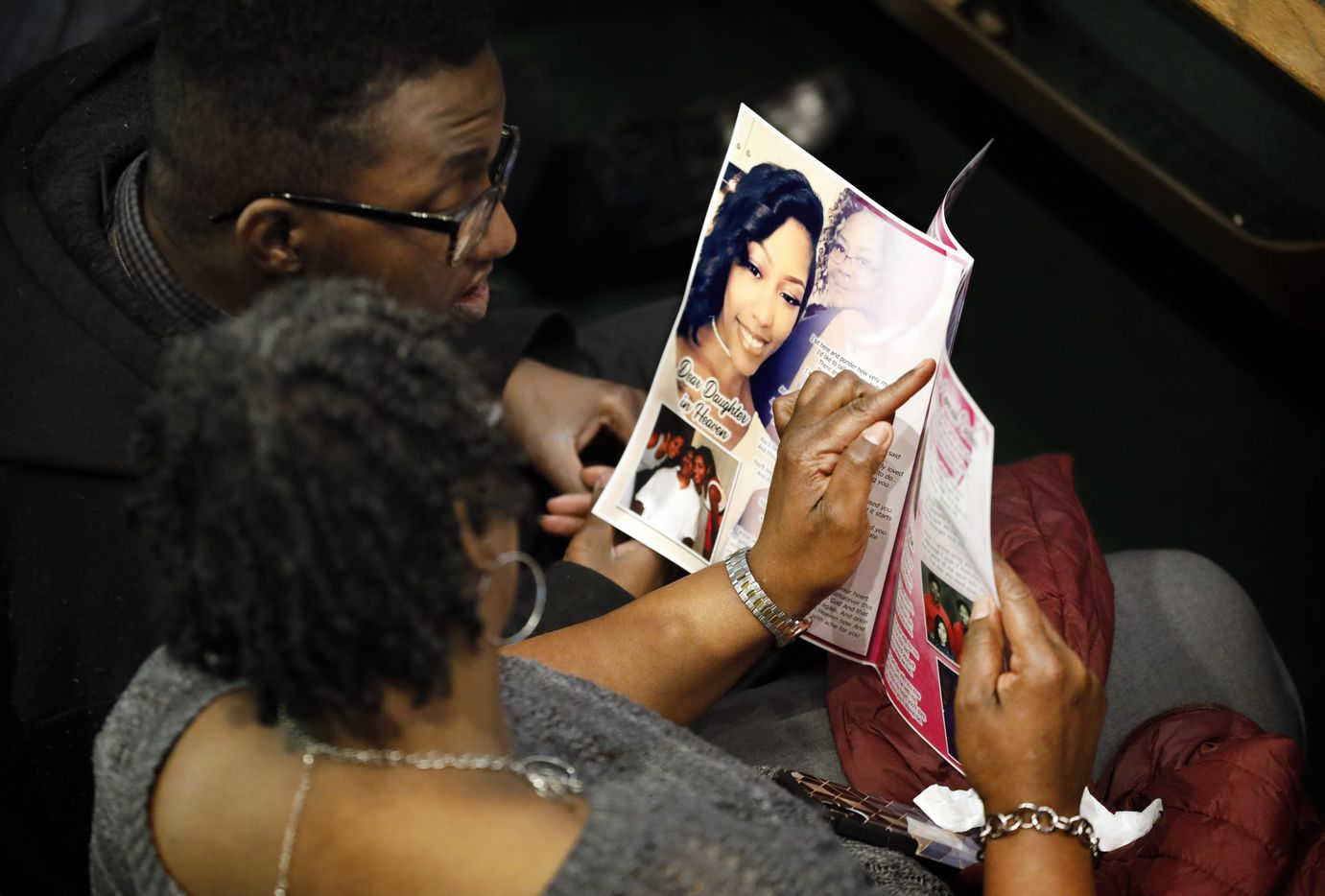 Mourners view photos of LaTiffiney Rodgers, 26, in the celebration of life program at her funeral service in CrossRoads Covenant Church in DeSoto, Texas, Saturday, February 22, 2020.